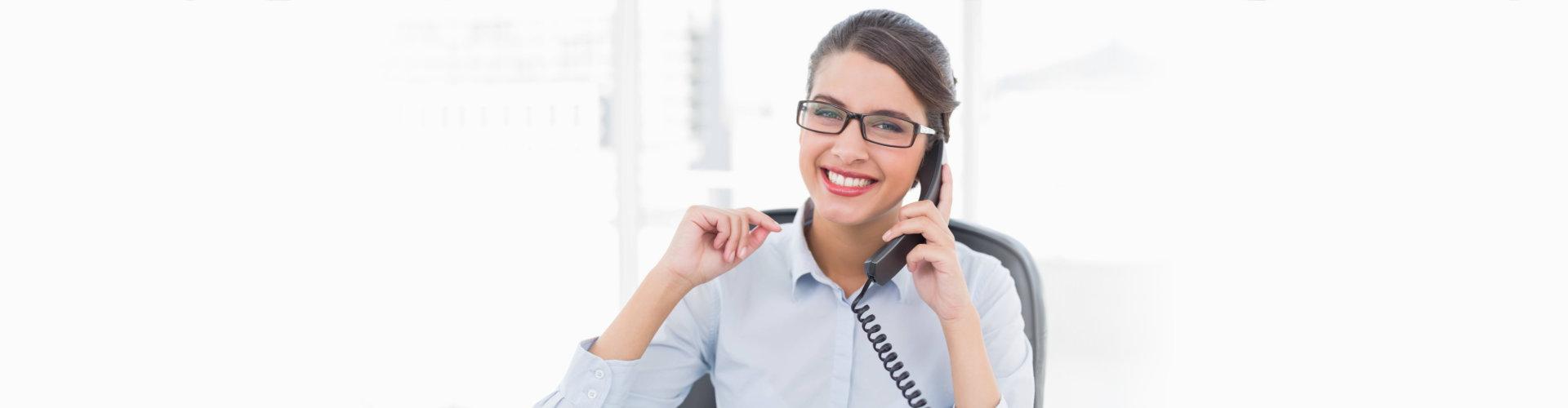 woman using telephone