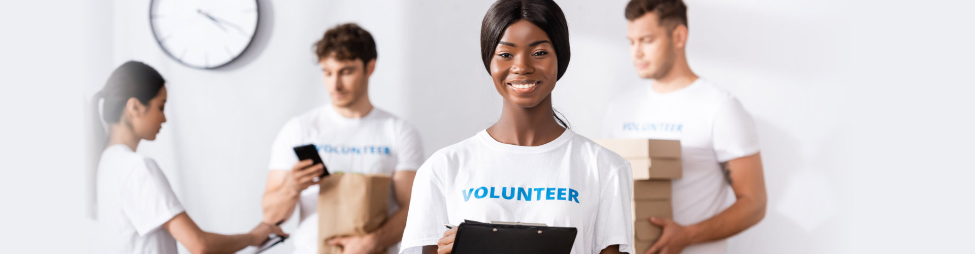 volunteer holding clipboard